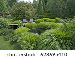 clipped box hedges  trees and... | Shutterstock . vector #628695410