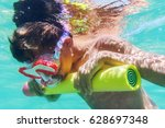funny child wearing diver mask... | Shutterstock . vector #628697348