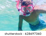 funny child wearing diver mask... | Shutterstock . vector #628697360