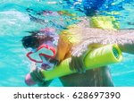 funny child wearing diver mask... | Shutterstock . vector #628697390