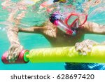 funny child wearing diver mask... | Shutterstock . vector #628697420
