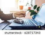 the man in the suit working in...   Shutterstock . vector #628717343