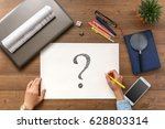 the girl sits at the table with ... | Shutterstock . vector #628803314
