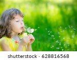 happy child blowing dandelion...   Shutterstock . vector #628816568