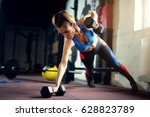 female hard work at gym with... | Shutterstock . vector #628823789