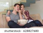 young handsome couple enjoying... | Shutterstock . vector #628827680