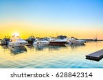 luxury yachts docked in sea... | Shutterstock . vector #628842314