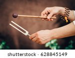 tuning fork in sound therapy | Shutterstock . vector #628845149