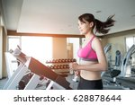 woman run on treadmill in the... | Shutterstock . vector #628878644