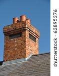 Old Brick Chimney On Black Til...