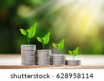 tree growing on coins stack... | Shutterstock . vector #628958114