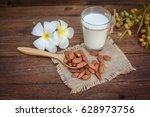 almond milk in glass with...   Shutterstock . vector #628973756