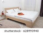 bedroom in soft light colors.... | Shutterstock . vector #628993940