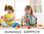 children playing with toys in... | Shutterstock . vector #628999178