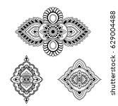 henna tattoo flower template....   Shutterstock .eps vector #629004488