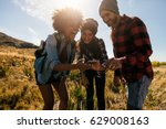 group of hikers looking at...   Shutterstock . vector #629008163