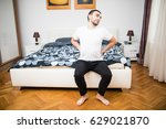 frustrated guy feels pain in...   Shutterstock . vector #629021870