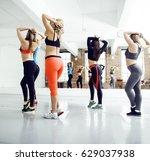 women doing sport in gym ... | Shutterstock . vector #629037938