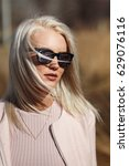 portrait of blonde in sunglasses | Shutterstock . vector #629076116