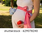 Belly Of Pregnant Girl In Whit...