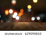 empty dark wood table top and... | Shutterstock . vector #629090810