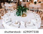 guest table  with bouquet from... | Shutterstock . vector #629097338