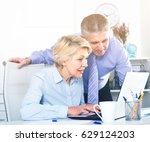 mature man helping his...   Shutterstock . vector #629124203