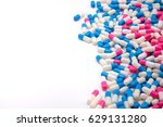 colorful capsules set on white... | Shutterstock . vector #629131280