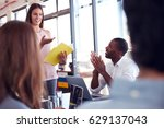 young woman addressing team at... | Shutterstock . vector #629137043