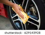 man worker cleaning car's alloy ... | Shutterstock . vector #629143928