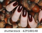 burgundy brown manicure on a... | Shutterstock . vector #629188148