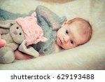 newborn baby lies in a crib... | Shutterstock . vector #629193488