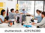 colleagues passing paperwork... | Shutterstock . vector #629196380