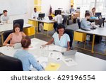 three women share a desk in a... | Shutterstock . vector #629196554