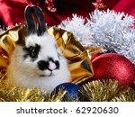 white rabbit and colored christmas toy composition - stock photo
