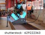 welder is welding steel... | Shutterstock . vector #629222363