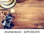 vintage photo camera  retro hat ... | Shutterstock . vector #629236154