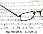 black reading glasses over the...