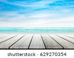 empty wooden table with party... | Shutterstock . vector #629270354