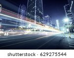 traffic through the modern city | Shutterstock . vector #629275544