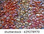 Assorted Red Pebble Background...