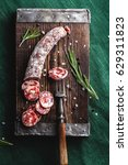 dried sausage on a rustic board ... | Shutterstock . vector #629311823