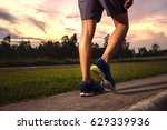 asian man action of jogging on... | Shutterstock . vector #629339936