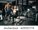 fitness instructor exercising... | Shutterstock . vector #629351774