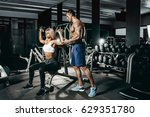 fitness instructor exercising... | Shutterstock . vector #629351780