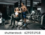 fitness instructor exercising... | Shutterstock . vector #629351918