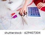 closeup seamstress takes...   Shutterstock . vector #629407304