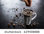 hot chocolate in a mug with nuts | Shutterstock . vector #629408888