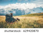 traveler with backpack relaxing ... | Shutterstock . vector #629420870