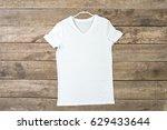 t shirt on wood plank   Shutterstock . vector #629433644